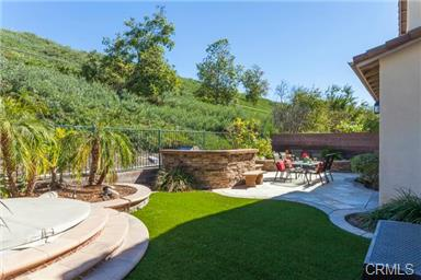 5 Hempstead St Ladera Ranch Outside is private and peaceful.  The custom landscaping include