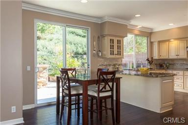 5 Hempstead St Ladera Ranch The casual dinner table overlooks the beautiful backyard.