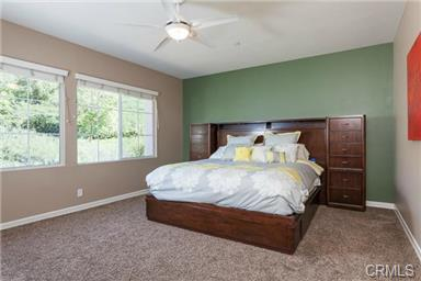 5 Hempstead St Ladera Ranch The master bedroom is spacious and overlooks your private slope.