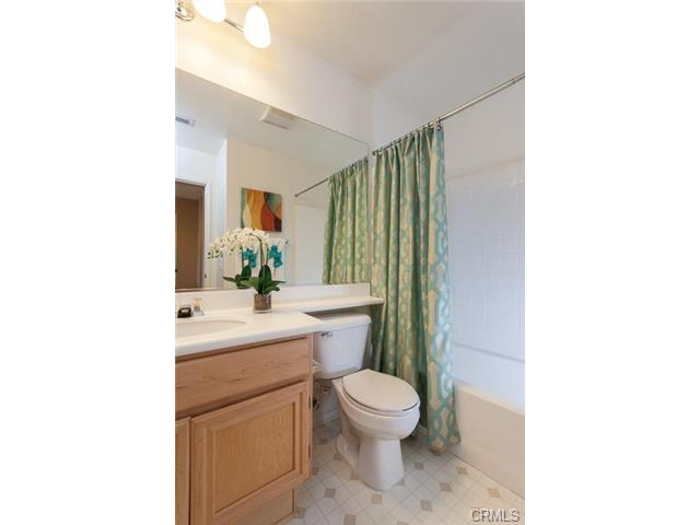 4 Benchmark Aliso Viejo The secondary bathroom is private with a tub.