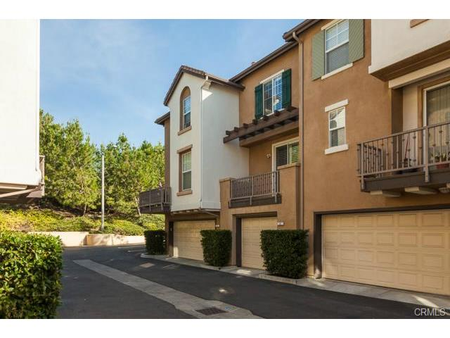 4 Benchmark Aliso Viejo A 2-car tandem garage has lots of storage space, plus the neighb