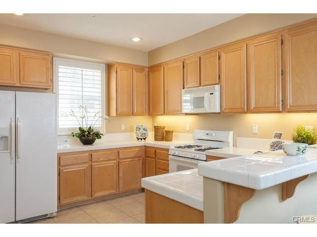 4 benchmark aliso viejo The sparkling kitchen is open with lots of counter space and cab