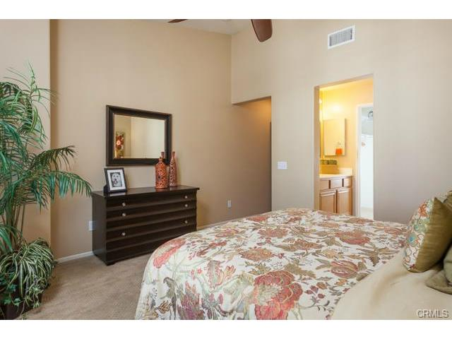 4 Benchmark Aliso Viejo The Master bedroom is spacious, light and bright.
