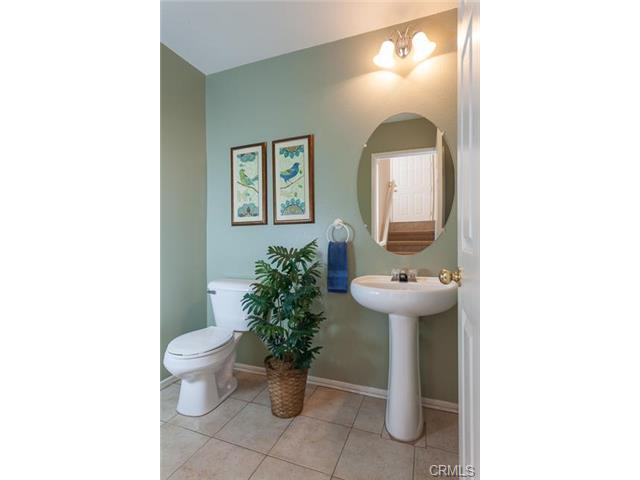 4 Benchmark Aliso Viejo The downstairs powder room is private with designer touches.