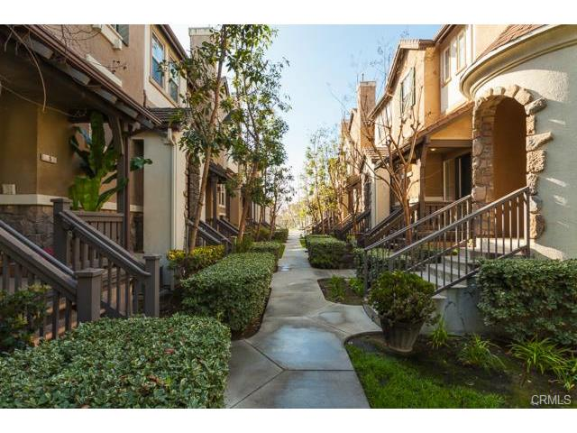 4 Benchmark Aliso Viejo A tree-lined path leads guests to your beautiful home.