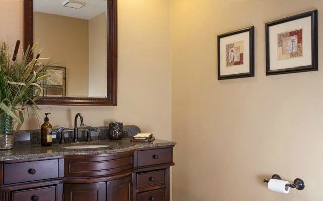 32 Crawford Tustin The designer vanity creates the perfect powder room.