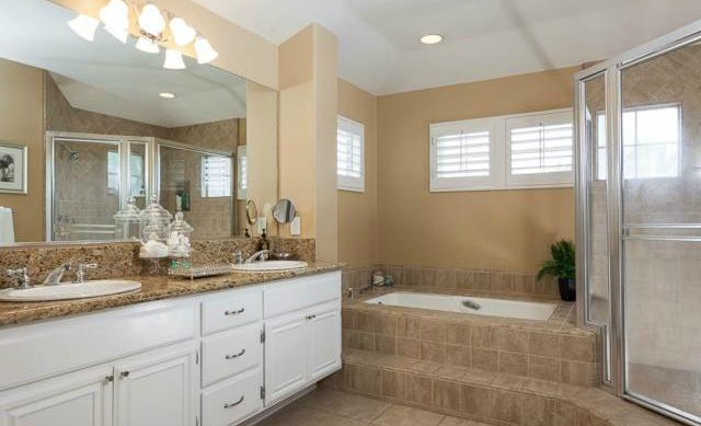 32 Crawford Tustin The Master Bath is redesigned with granite countertops, tiled so