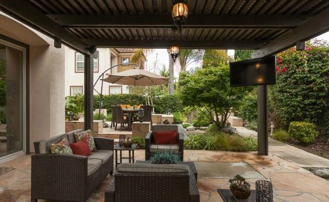32 Crawford Tustin Mature trees and lush landscaping create a private space for you