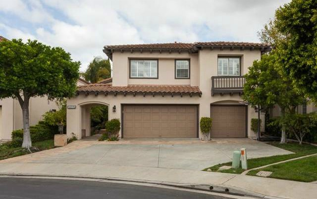 32 Crawford Tustin The three car garage allows for extra storage and includes overh