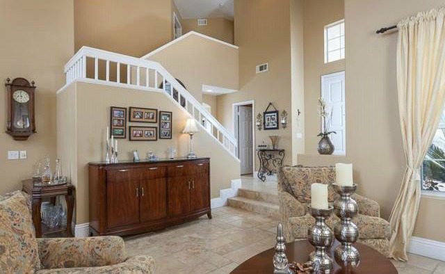 32 Crawford Tustin Cathedral ceilings create a dramatic living room with distressed