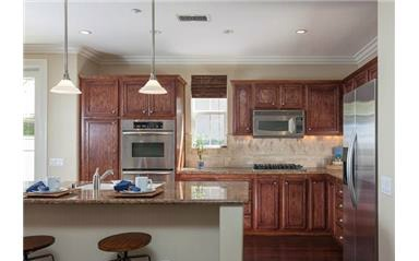 2 laurelhurst dr The kitchen has stainless appliances including a double oven, 4