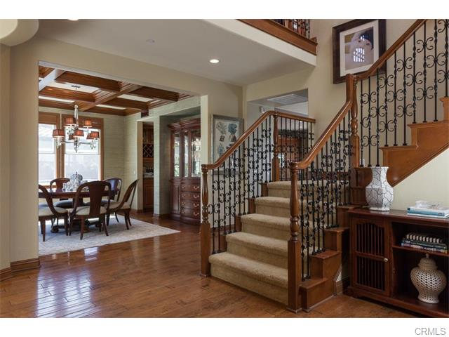 3 Drackert Ln The entry showcases rich wood floors, wrought iron staircase and