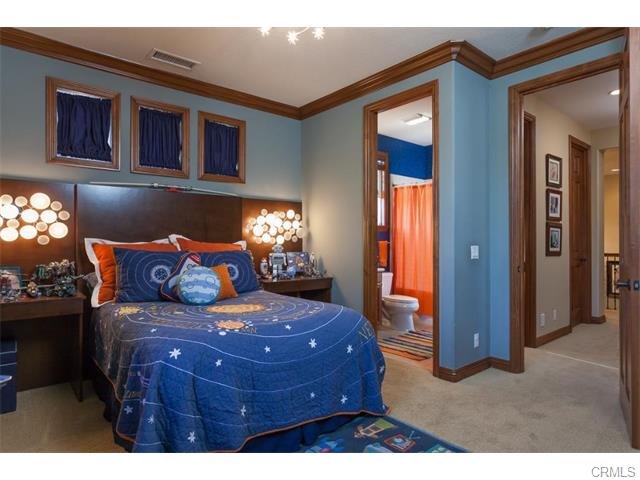 3 Drackert Ln This custom bedroom includes a custom, builtin head board and li