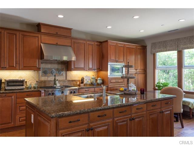 3 Drackert Ln The gourmet kitchen boasts granite counter tops, a stone backspl
