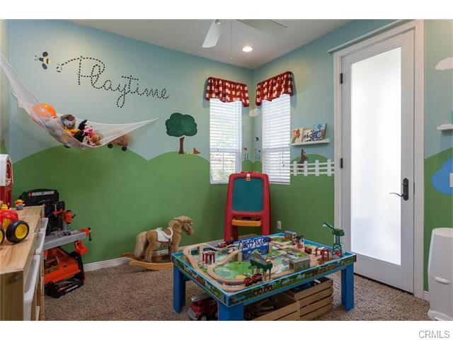 Downstairs is another bedroom, perfect for a playroom, office or