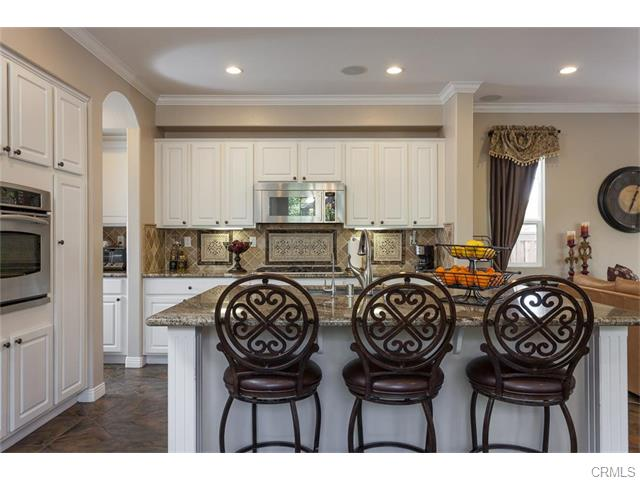 The island kitchen has a walk in pantry and ample counter space.
