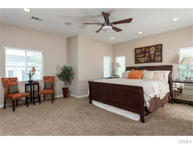 Upstairs is a large master retreat with room for a sitting area.