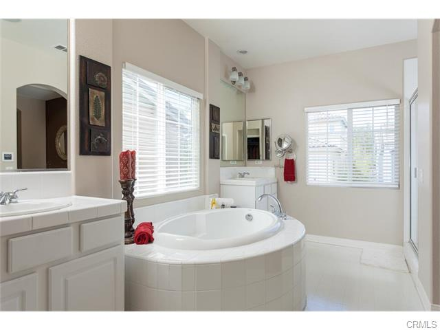 The master bath is fresh and clean, complete with a walk in clos