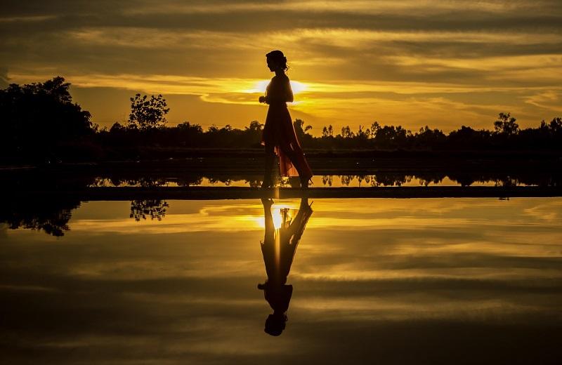 Walks in Newport Beach Woman Walking Along Water