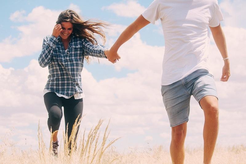 Walks in Newport Beach Couple Walking in Tall Grass