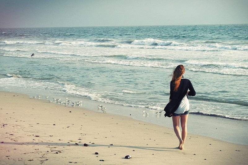 Walks in Newport Beach Woman Walking on a Beach