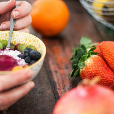 Fruit Salad Side Dishes Person Holding a Bowl with Fruit Inside