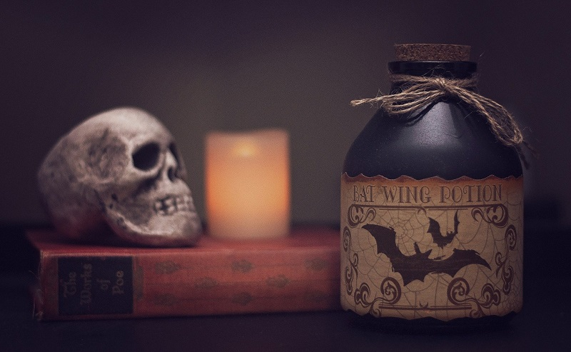 Margarita Recipes A Spooky Jar on a Counter with a Skull and a Candle