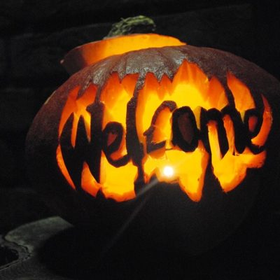Margarita Recipes a Pumpkin with the Word Welcome Carved in t