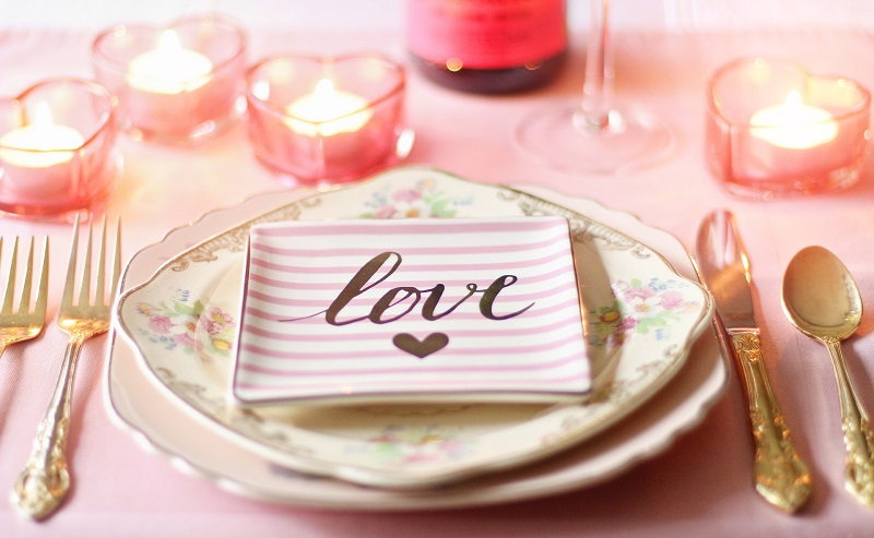 Valentine's Day at Home Dinner Ideas Pink and White Table Setting with the Word Love Written On it